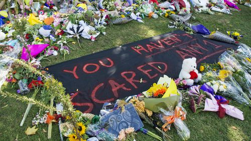 Floral tributes and messages are seen along Rolleston Avenue in Christchurch.