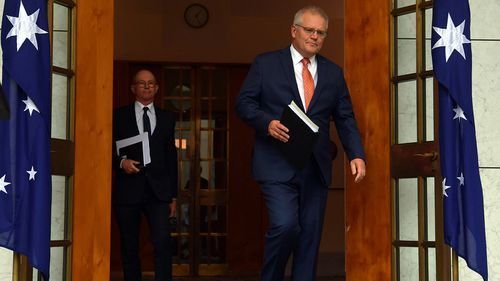 Prime Minister Scott Morrison arrives with Chief Medical Officer Paul Kelly to brief the media on today's National Cabinet meeting.