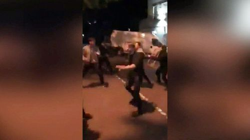 Melbourne police are hunting for a group of teenagers involved in a brawl outside a McDonalds restaurant in Collingwood.