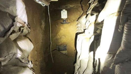 A hidden shooting range underneath a gangster's home uncovered during a police raid.