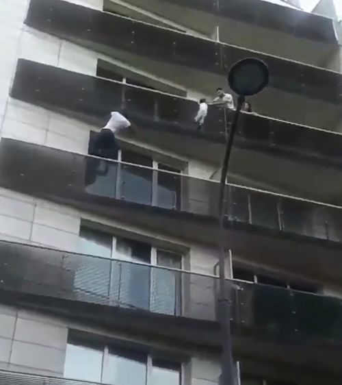 Onlookers cheered and filmed him as he leapt from balcony to balcony faster than the people above the child could reach the toddler. Picture: Supplied.