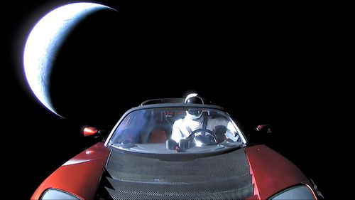 "In this handout photo provided by SpaceX in February, a Tesla roadster launched from the Falcon Heavy rocket with a dummy driver named ""Starman""  heads towards Mars. (Photo by SpaceX via Getty Images)"