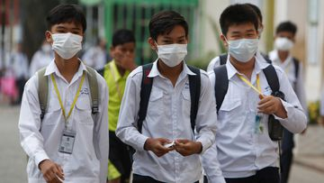 Students wear masks to avoid the contact of coronavirus at a high school in Phnom Penh, Cambodia.