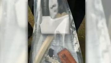 A photo of a knife and tomahawk found during the spot prison search in Western Australia.