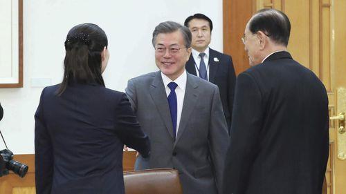 South Korean President Moon Jae-in, center, shakes hands with Kim Yo Jong, left, sister of North Korean leader Kim Jong Un (AAP)