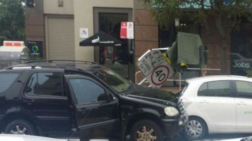 The 4WD is believed to have mounted the kerb on Redfern Street. (Twitter, James Brechney)