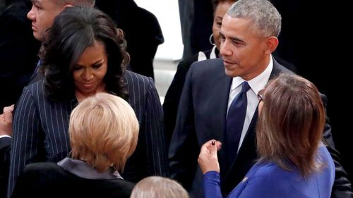 Michelle and Barack Obama arrive for the funeral of George HW Bush.