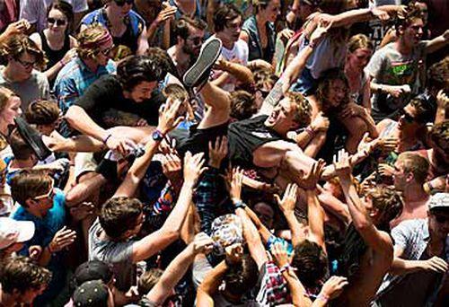 Music festival crowd surfing (Getty)