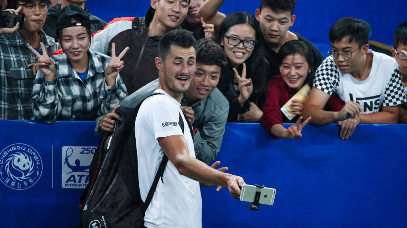 Tennis: Bernard Tomic saves match point to win in Chengdu