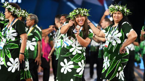 Athletes from Fiji smile as they arrive during the Opening Ceremony. (Getty Images)