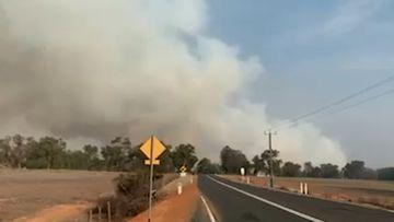 A bushfire threatened homes in GinGin, almost 70km north of Perth, WA.