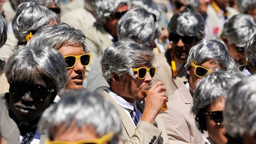 The former cricketer and commentator attracted a cult following among cricket fans, who often mimicked his look. (Getty Images)