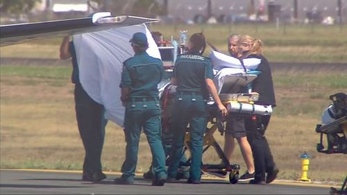 A Melbourne girl was holidaying with her father and sister when she received a life-threatening wound to her right leg on Thursday while swimming in shallow water in Cid Harbour.