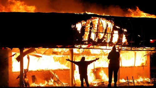 Buildings burn in Ferguson protests after officer cleared