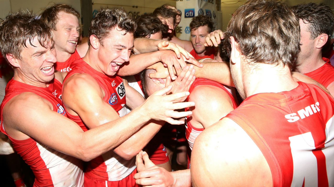 Sydney Swans first gamer Ben Ronke is congratulated
