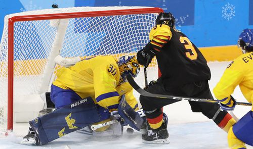 Patrick Reimer (C) of Germany scores the winning goal against goalie Viktor Fasth of Sweden during the men's play-offs Quarterfinals match in PyeongChang. (AAP)