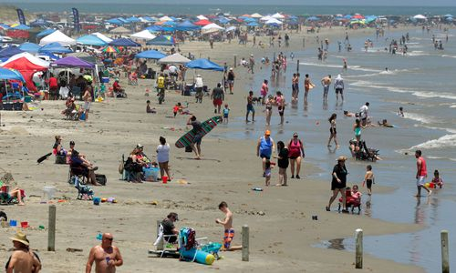 People gather on the beach for the Memorial Day weekend in Port Aransas, Texas.