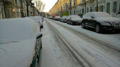 Cars are covered in snow in London on Wednesday. (9NEWS)