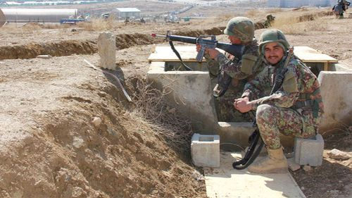 Afghan soldiers during a training drill. (9NEWS)
