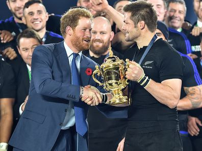 Prince Harry presents Richie McCaw with the Webb Ellis Cup after New Zealand beat Australia in the 2015 Rugby World Cup Final