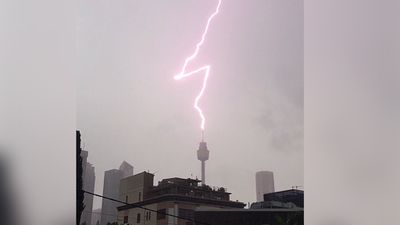 Lighting strikes Sydney Tower in the city. (Instagram/mikejmorrow_ig)