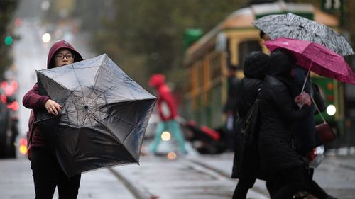 Melburnians will need to hang on to their brollies this afternoon. Picture: File/ AAP