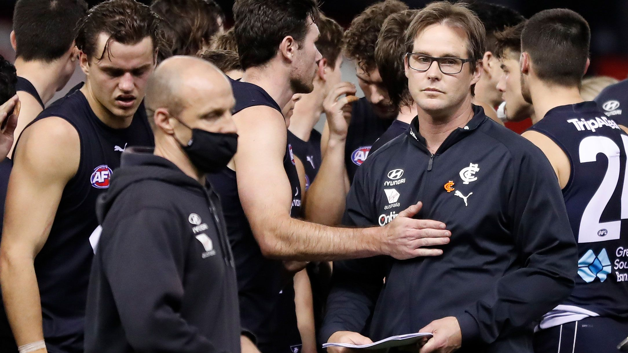 David Teague is consoled by Mitch McGovern of the Blues.