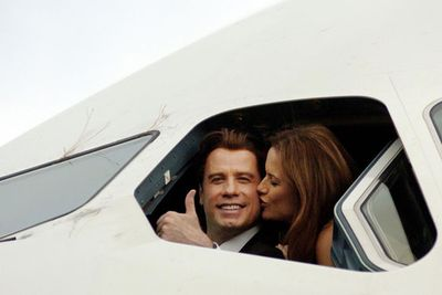 """John admitted that him and his wife Kelly Preston once """"got a bit carried away in the cockpit"""" when he was flying his jet.<br/><br/>Imagine what the co-pilot has seen!<br/><br/>(Image: Getty)"""