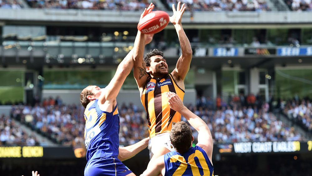 Cyril Rioli takes a mark in the 2015 Grand Final. (AAP)