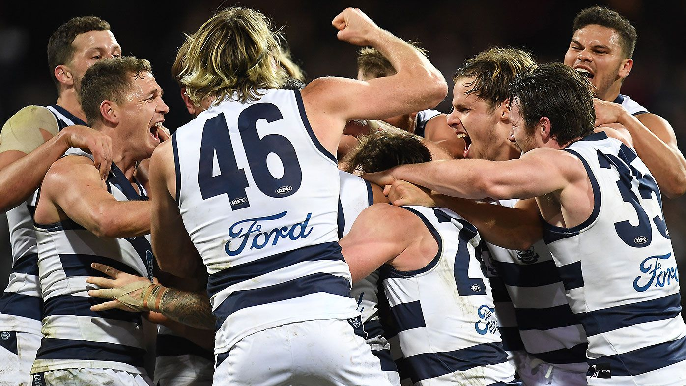 Geelong players celebrate