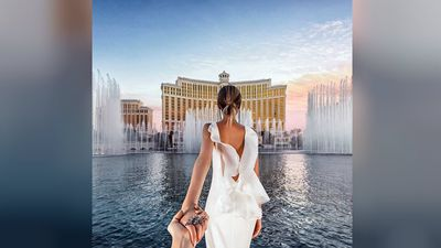 In the first photo on Instagram after the wedding, Nataly leads Murad in front of the iconic Bellagio fountains in Las Vegas. (muradosmann, Instagram)