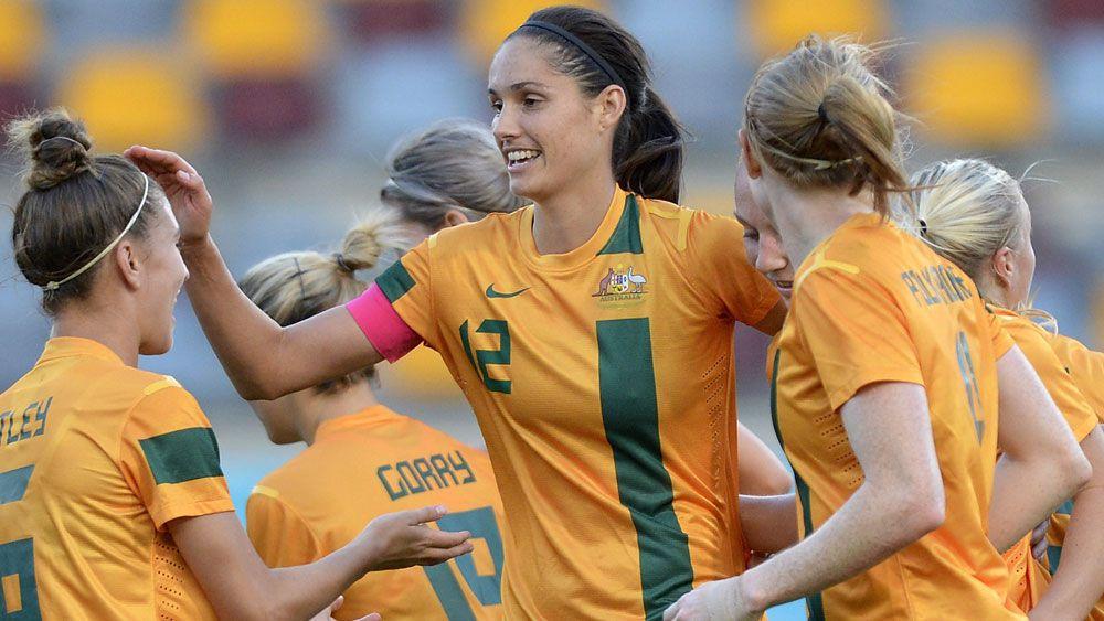 Kate Gill celebrates a goal with her Matildas teammates. (Getty)
