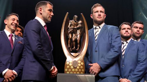 Storm captain Cameron Smith and Cowboys captain Gavin Cooper are seen next to the Provan Summons Trophy at Luna Park in Sydney. (AAP)