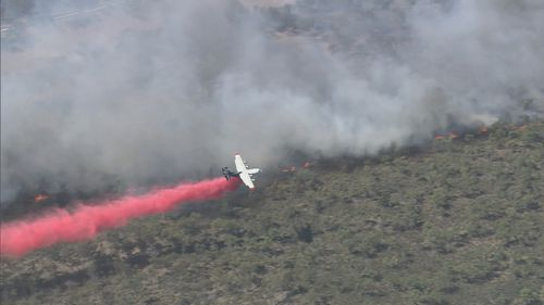 The bushfire burned through more than 70 hectares of land north of Perth.