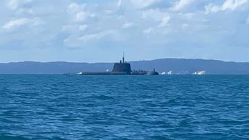A submarine has been spotted off the southeast Queensland coast this morning in the most recent sighting of heightened military activity in the sunshine state.