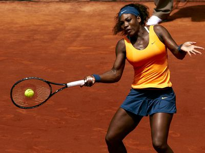 Serena popped in neon orange while playing in the 2013 Mutua Madrid Open in Spain, 2013.