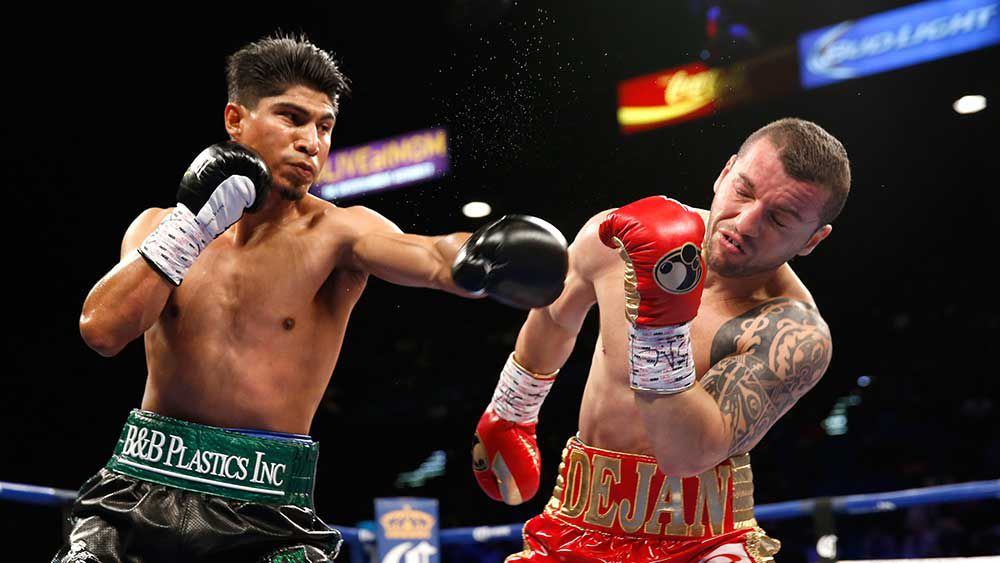 Boxing: Garcia delivers brutal knockout to win third title