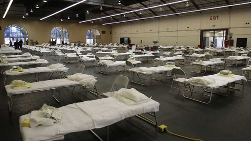 Cots are set up at a possible COVID-19 treatment site in San Mateo, California.