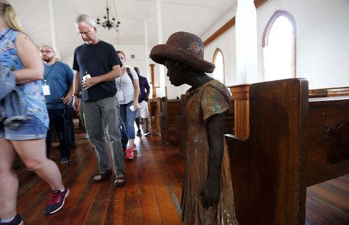 Black slave children were taken from their families in the past. Pictured is a sculpture of a slave girl inside the Antioch Baptist Church, at the Whitney Plantation in Edgard, La. (AP)