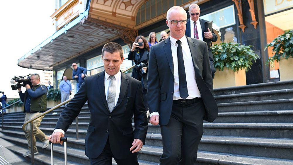 Former Eels boss Scott Seward (right) leaves court. (AAP)