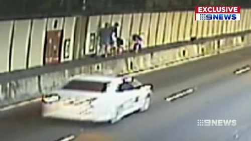 The pair managed to climb a barrier before Transurban officers picked them up.