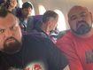 Strongman champions squeeze into tiny plane seats
