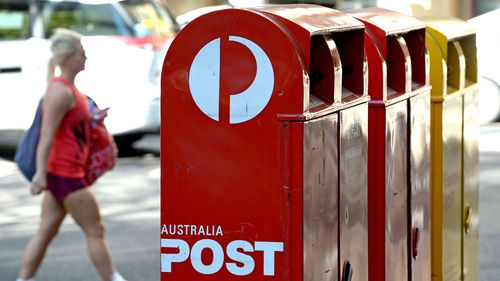 Australia Post posts first full year loss in more than 30 years