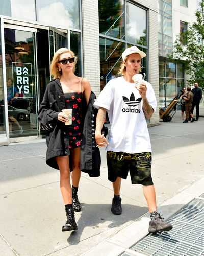 Hailey Baldwin and Justin Bieber leave Barry's Bootcamp Tribeca store on July 27, 2018 in New York City.
