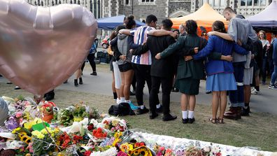 Students embrace at Botanical Gardens in Christchurch