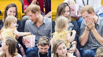 Naughty toddler steals popcorn from Prince Harry