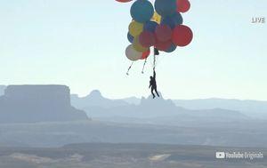 David Blaine flies over the Arizona desert holding onto helium balloons