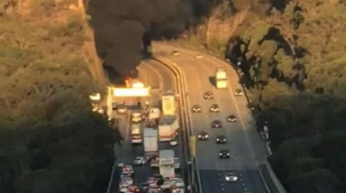 Smoke could be seen billowing up from the crash site. Image: 9News