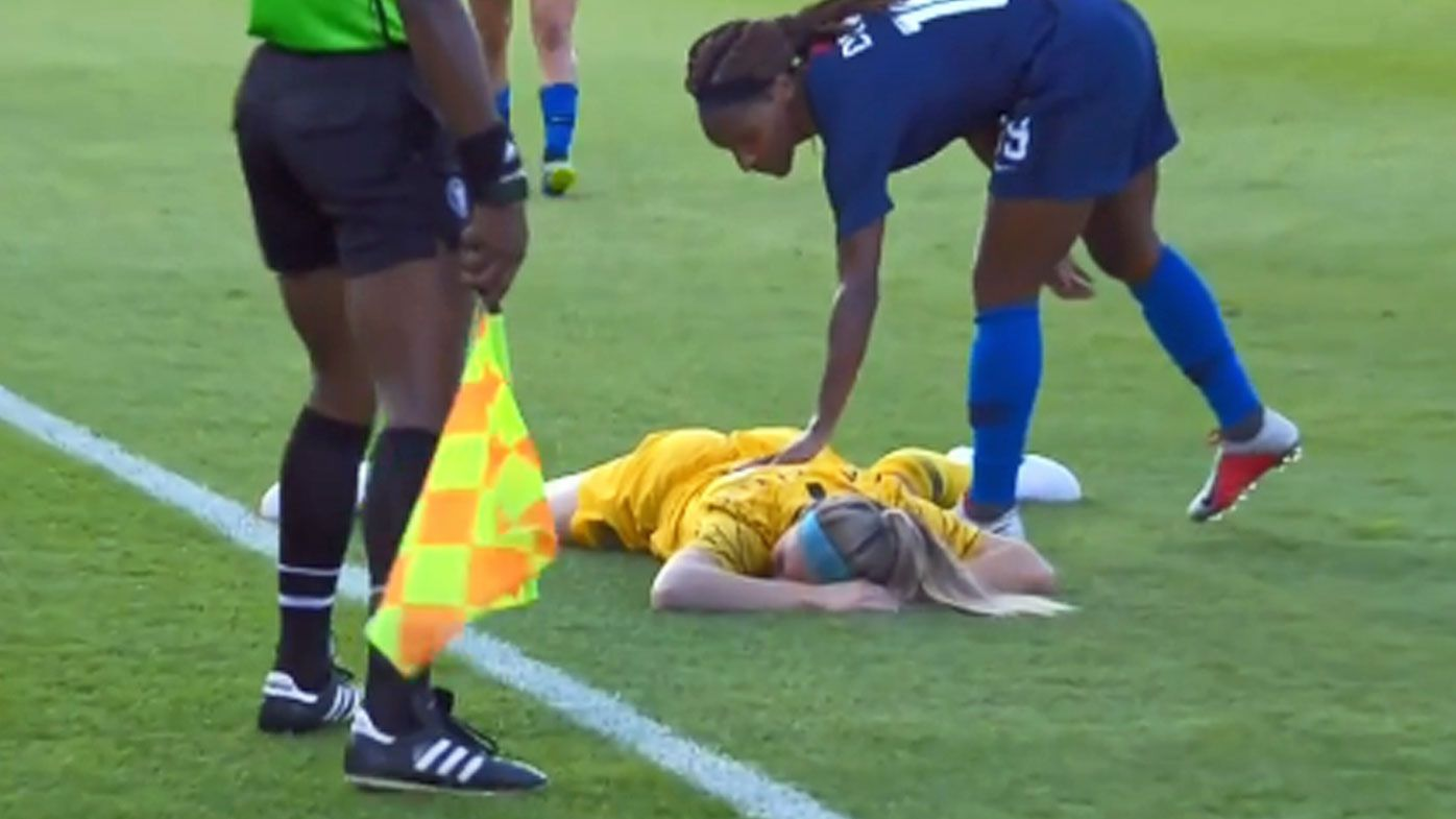 Matildas defender Ellie Carpenter flattened by 'absolutely vicious clearance'