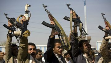 Houthi Shiite Yemeni raise their weapons during clashes near the presidential palace in Sanaa, Yemen. (AP)